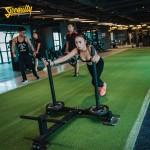 Sự kết hợp hoàn hảo gạch cao su và cỏ nhân tạo cho sàn phòng gym